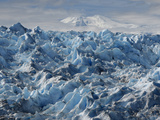 Lautaro, An Active Volcano, Looms Over the Surface of Pio XI Glacier Photographic Print by Maria Stenzel