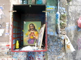 Christian Shrine in Wooden Box on a Street Wall, with Candle, Marigolds and Offerings, Colaba Back  Photographic Print by Annie Owen