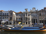 Moliceiro Boats Docked by Art Nouveau Style Buildings Along the Central Canal, Aveiro, Beira Litora Photographic Print by Stuart Forster