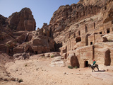 Child Riding a Donkey in Front of Cave Dwellings in Petra, UNESCO World Heritage Site, Jordan, Midd Fotografie-Druck von Martin Child