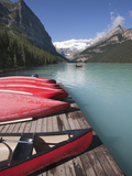 Canoes for Hire on Lake Louise, Banff National Park, UNESCO World Heritage Site, Alberta, Rocky Mou Photographic Print by Martin Child