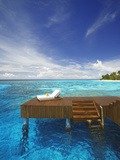 Sun Lounger and Jetty in Blue Lagoon on Tropical Island, Maldives, Indian Ocean, Asia Fotografisk tryk af Sakis Papadopoulos