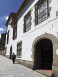 A Man Walks Past the Manueline Coimbras House (Casa Dos Coimbras) at Santa Cruz Square, Braga, Minh Photographic Print by Stuart Forster