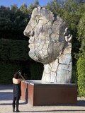 Young Woman Taking Photograph of the Monumental Head, by Igor Mitora, Boboli Gardens, Florence, Tus Reprodukcja zdjęcia autor Peter Barritt