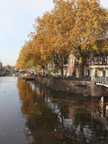 Autumnal Leaves Reflect in the Water of a Canal in Central Utrecht, Utrecht Province, Netherlands,  Photographic Print by Stuart Forster