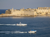 Fort Ricasoli from Valletta, with Yacht and Water Taxi Passing, Malta, Mediterranean, Europe Photographic Print by Nick Servian