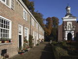 Chapel and Brick Housing Within the Courtyard of the Begijnhof (Beguinage) in Breda, Noord-Brabant, Photographic Print by Stuart Forster