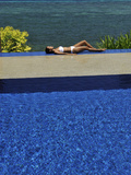 Girl at the Pool at Eskaya Beach Resort and Spa, Bohol, Philippines, Southeast Asia, Asia Photographic Print by Luca Tettoni