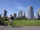 Cyclist Passing Apartment Blocks, False Creek, Vancouver, British Columbia, Canada, North America Fotoprint van Martin Child