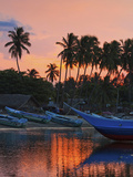 Boats and Palm Trees at Sunset at This Fishing Beach and Popular Tourist Surf Spot, Arugam Bay, Eas Photographic Print by Robert Francis