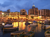 Evening across Spinola Bay with Restaurants, St. Julian`S, Malta, Mediterranean, Europe Fotografie-Druck von Stuart Black