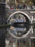 A Sightseeing Barge under a Bridge on the Oudegracht Canal in the Dutch City of Utrecht, Utrecht Pr Photographic Print by Stuart Forster