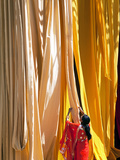 Woman in Sari Checking the Quality of Freshly Dyed Fabric Hanging to Dry, Sari Garment Factory, Raj Photographie par Gavin Hellier