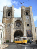 Tram and Se (Cathedral), Alfama, Lisbon, Portugal, Europe Photographic Print by Vincenzo Lombardo