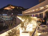 Rooftop Terrace Bar at the Athens Hilton with Lykavittos Hill Illuminated at Night, Athens, Greece, Photographic Print by Martin Child