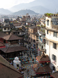View over Narrow Streets and Rooftops Near Durbar Square Towards the Hilltop Temple of Swayambhunat Photographie par Lee Frost