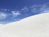 Wind Blows White Sand across the Top on Dune, under a Blue Sky, at Lancelin, Western Australia, Aus Photographic Print by Stuart Forster