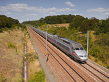 A Tgv Train Speeds Through the French Countryside Near to Tours, Indre-Et-Loire, Centre, France, Eu Photographic Print by Julian Elliott