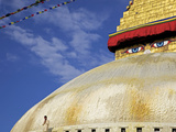 Man Praying in Front of the Dome of Boudha (Bodhnath) (Boudhanath) Stupa, Kathmandu, UNESCO World H Photographic Print by Simon Montgomery