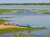 Canoes by Arugam Lagoon, known for its Wildlife, Pottuvil, Arugam Bay, Eastern Province, Sri Lanka, Photographic Print by Robert Francis