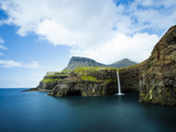 Village of Gasadalur Overlooked by the 612M Heinanova Mountain, Vagar Island, Faroe Islands, Denmar Photographic Print by Kimberley Coole