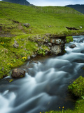 A Stream Running Through Village of Gasadalur, Which Is Overlooked by the 612M Heinanova Mountain,  Photographic Print by Kimberley Coole