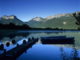 Silhouette of Pier and Rowing Boats, Lake Annecy, Rhone Alpes, France, Europe Photographic Print by Stuart Black