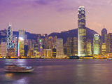 The Skyscrapers of Hong Kong Island Illuminated at Sunset across Victoria Harbour, Two Internationa Photographic Print by Amanda Hall