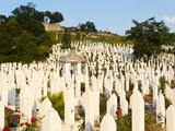 Kovaci War Cemetery with Gravestone of First President of Bosnia and Herzegovina, Alija Izetbegovic Photographic Print by Emanuele Ciccomartino