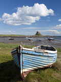 Old Wooden Fishing Boat on a Grassy Bank with Lindisfarne Harbour and Lindisfarne Castle, Holy Isla Photographic Print by Lee Frost