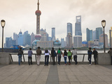 People Viewing the Pudong Skyline and the Oriental Pearl Tower from the Bund, Shanghai, China, Asia Photographic Print by Amanda Hall