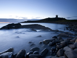 The Ruins of Dunstanburgh Castle at Dawn with Greymare Rock Partly Sumberged and the Sea, Embleton  Photographic Print by Lee Frost