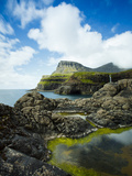 Village of Gasadalur Overlooked by the 612M Heinanova Mountain, Vagar Island, Faroe Islands, Denmar Photographic Print by Kimberley Coole