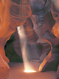 Sunbeam Illuminates Sandy Floor and Sandstone Walls of a Slot Canyon, Antelope Canyon, Page Photographic Print by Dennis Flaherty