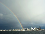 A Rainbow Lands on a Washington State Ferry in the Puget Sound with the Seattle Skyline in the Back Photographic Print by Aaron McCoy