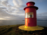 Lighthouse on Bluff Above Stykkisholmer, Iceland Photographic Print by Dave Bartruff