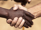 Black and White Male's Handshake, Opuwo, Namibia, Africa Photographic Print by Wendy Kaveney