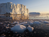 Midnight Sun Lights Massive Icebergs from Jakobshavn Glacier, Disko Bay, Ilulissat, Greenland Photographic Print by Paul Souders