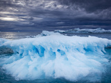 Melting Iceberg Floating Near Face of Jakobshavn Isfjord on Stormy Evening, Ilulissat, Greenland Photographic Print by Paul Souders