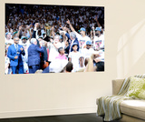 Miami, FL - June 21:  Team owner Micky Arison of the Miami Heat holds up the Larry O'Brien Champion Wall Mural by Ronald Martinez