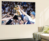Miami, FL - June 21:  The Miami Heat celebrate with the Larry O'Brien Finals Championship trophy. Prints by Ronald Martinez