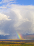 Cumulus Clouds and Rainbow over Tundra and Distant Snowy Alaska Range Photographic Print by John Eastcott & Yva Momatiuk