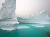 Iceberg with Steep Walls and Patterns Created by Melting and Waves Photographic Print by John Eastcott & Yva Momatiuk