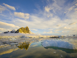 Steep Mountain and Glaciers Reflecting in Sea Filled with Ice Chunks Photographic Print by John Eastcott & Yva Momatiuk