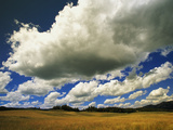 Cumulus Clouds Hover Above a Meadow Near Togwotee Pass Photographic Print by John Eastcott & Yva Momatiuk