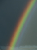 A Rainbow Arches across a Storm-Filled Sky Photographic Print by John Eastcott & Yva Momatiuk
