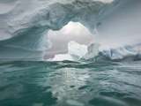 Floating Icebergs, Ice Arch and Sea Waves Seen from Water's Surface Photographic Print by John Eastcott & Yva Momatiuk