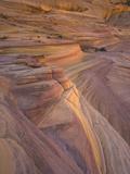 Fantastic Landscape of Colorful and Twisted Sandstone Layers Fotografisk tryk af John Eastcott & Yva Momatiuk