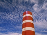 A Water Tower Set Against a Background of Cirrus Clouds in the Sky Photographic Print by John Eastcott & Yva Momatiuk