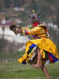A Masked Dancer with Cymbals Performs Drametse Nga Cham (The Religious Masked Dance) Photographic Print by Nigel Pavitt
